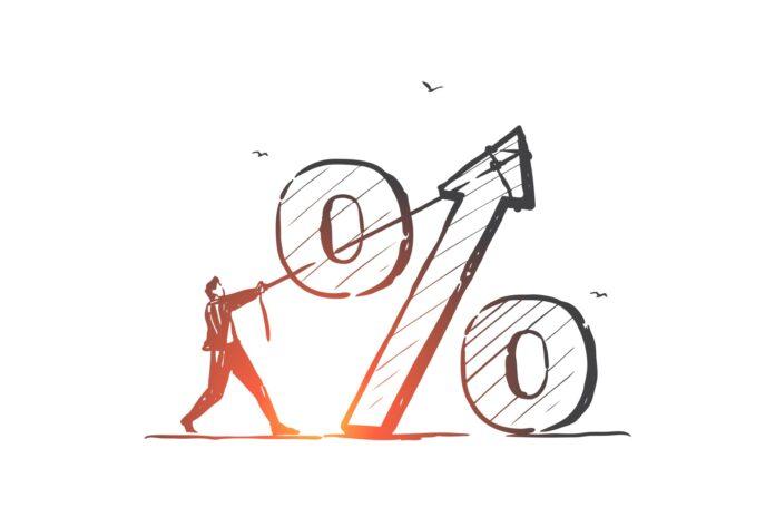 Mężczyzna siłujący się ze stopą procentową