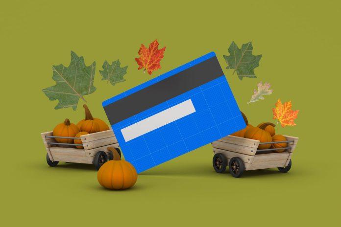 Karta kredytowa na tle liści i dyni